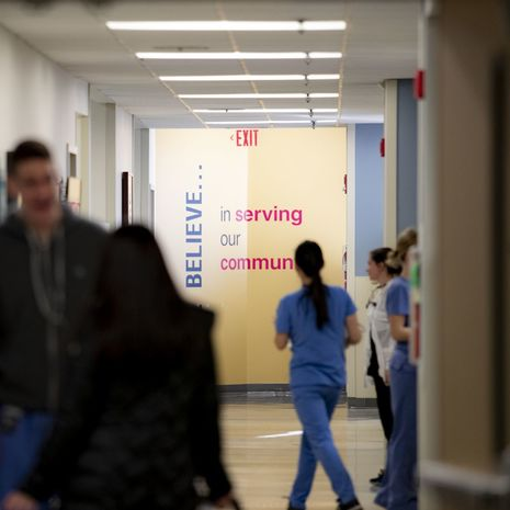 Dental residents and students walking through hallway in Kornberg School of Dentistry