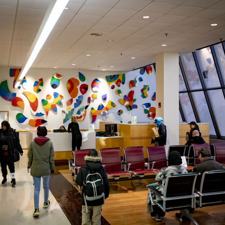 Waiting room at Kornberg School of Dentistry clinic with colorful wall installation