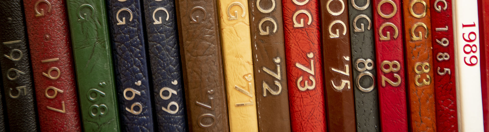 A row of yearbooks from the Kornberg School of Dentistry.