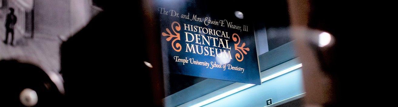 A sign outside of the Kornberg School of Dentistry's museum.
